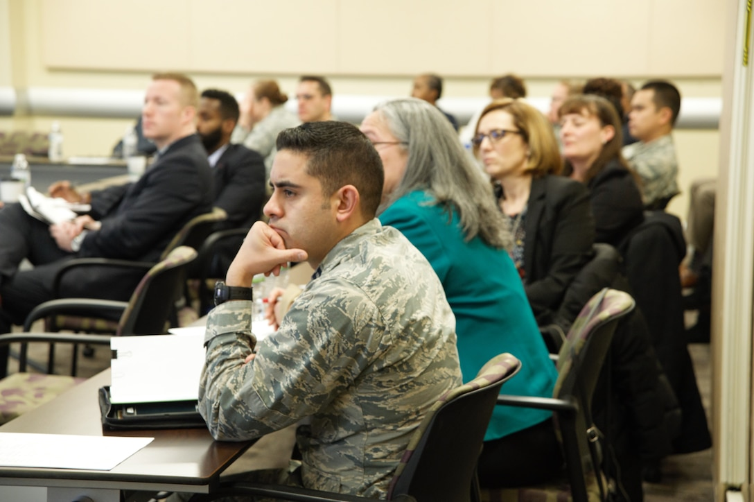 Military and civilian attendees listen to discussions during the Air Force District of Washington Financial Management and Comptroller Conference in the Smart Conference Center here March 1, 2018