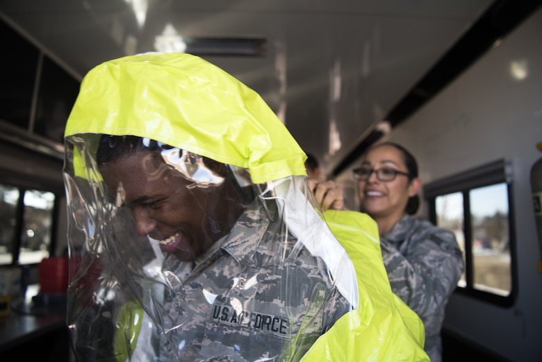 Airman 1st Class Trayvon Parker, 90th Comptroller Squadron financial services technician, tries on the hazardous materials suit while visiting Bioengineering during the Mission Immersion Day at F.E. Warren Air Force Base, Wyo., Feb. 27, 2018. The Airmen took a tour of the medical facilities to get a better understanding of the behind the scenes jobs that keep the clinic running. The Mission Immersion Day was put together to allow Airmen the opportunity to exercise cross communication between the different career fields on base. (U.S. Air Force photo by Airman 1st Class Abbigayle Wagner)