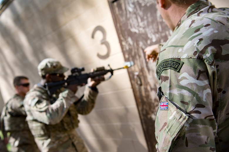 British Royal Air Force Sgt. Glenn Risebrow, right, 15th Squadron senior noncommissioned officer in charge of training, provides training points to Airmen from the 824th Base Defense Squadron during close-quarters battle training, Feb. 28, 2018, at Moody Air Force Base, Ga. The 820th Base Defense Group welcomed a member of the British Royal Air Force to embed into multiple training situations to help strengthen combined operations between U.S. and British forces. (U.S. Air Force photo by Senior Airman Daniel Snider)