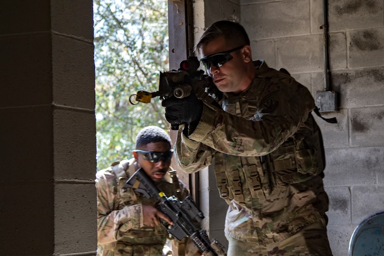 Airmen from the 824th Base Defense Squadron storm a building during close-quarters battle training, Feb. 28, 2018, at Moody Air Force Base, Ga. The 820th Base Defense Group welcomed a member of the British Royal Air Force to embed into multiple training situations to help strengthen combined operations between U.S. and British forces. (U.S. Air Force photo by Senior Airman Daniel Snider)