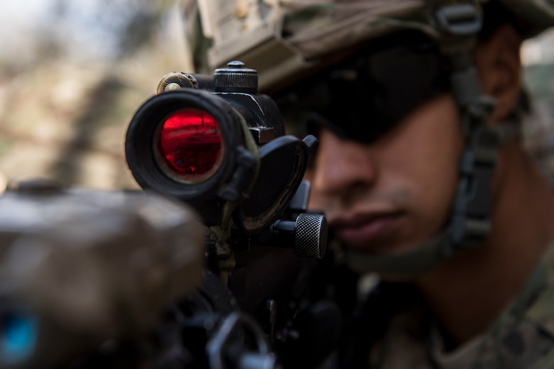 An Airman from the 824th Base Defense Squadron guards an entrance to a building during close-quarters battle training, Feb. 28, 2018, at Moody Air Force Base, Ga. The 820th Base Defense Group welcomed a member of the British Royal Air Force to embed into multiple training situations to help strengthen combined operations between U.S. and British forces. (U.S. Air Force photo by Senior Airman Daniel Snider)