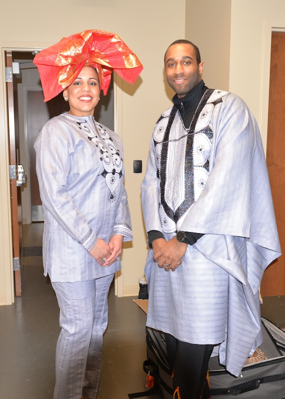 Master Sgt. Yusef Kennedy, the 28th Medical Support Squadron medical logistics flight chief, and Staff Sgt. Adrianne Littles, a 28th Medical Operations Squadron medical technician, pose in their authentic West African attire for an African American History Month event at Ellsworth Air Force Base, S.D., Feb. 23, 2018. Models displayed the versatility of the Dashiki, an African clothing item that can be worn by men and women. (U.S. Air Force photo by Senior Airman Michella T. Stowers)
