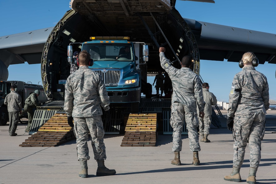 Members from multiple mission partners gathered to help load the aircraft for the Space and Missile Systems Center detachment at Kirtland. The equipment was being moved to Diego Garcia for a satellite operations mission.