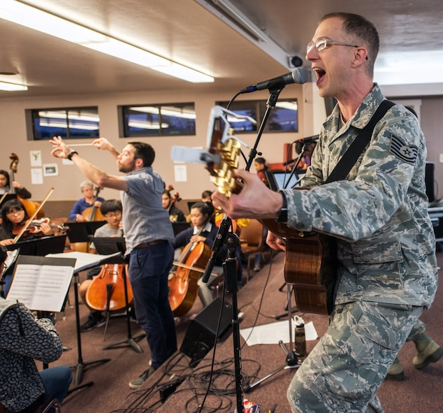 "Musicians from the rock music group ""Mobility"" of The United States Air Force Band of the Golden West, Travis Air Force Base, Calif., practice with the Napa Valley Youth Symphony at the Napa Christian Academy, Napa, Calif., Feb. 25, 2018. The band and symphony are practicing together for an upcoming performance. The original performance, scheduled in October 2017, was canceled due to devastating wildfires in Napa and Sonoma counties. (U.S. Air Force photo by Louis Briscese)"