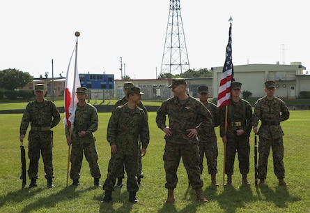 Brigadier General Christopher A. McPhillips, Commanding General, 3D Marine Expeditionary Brigade, and Major General Shinichi Aoki, Deputy Chief of Staff, Japan Ground Self-Defense Force Western Army, stand side by side at Camp Cortney, Okinawa, Japan, December 5, 2017.