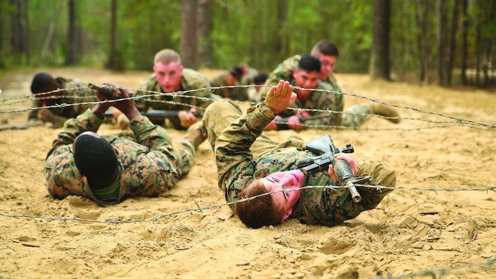 Marines maneuver through an obstacle during the combat endurance course aboard Marine Corps Recruit Depot Parris Island, Feb. 28.