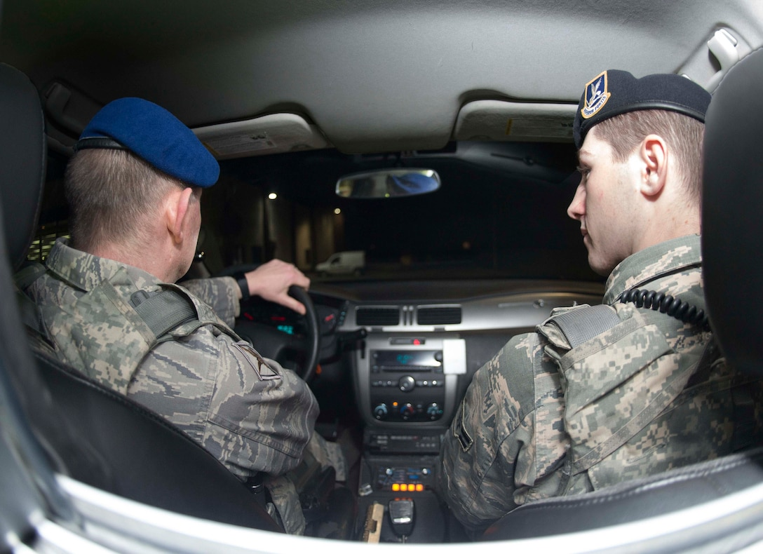 Zivilpolizei Marcus Mueller, left, 86th Security Forces Squadron Patrolman, drives a patrol vehicle with U.S. Air Force Airman 1st Class Daniel Regan, 86th SFS member, on Ramstein Air Base, Germany, Feb. 26, 2018. Zivilpolizei, or Civilian Security Police, are the civilian side of the 86th SFS, and they bring a wealth of experience to Ramstein's law enforcement. (U.S. Airforce photo by Senior Airman Baker)