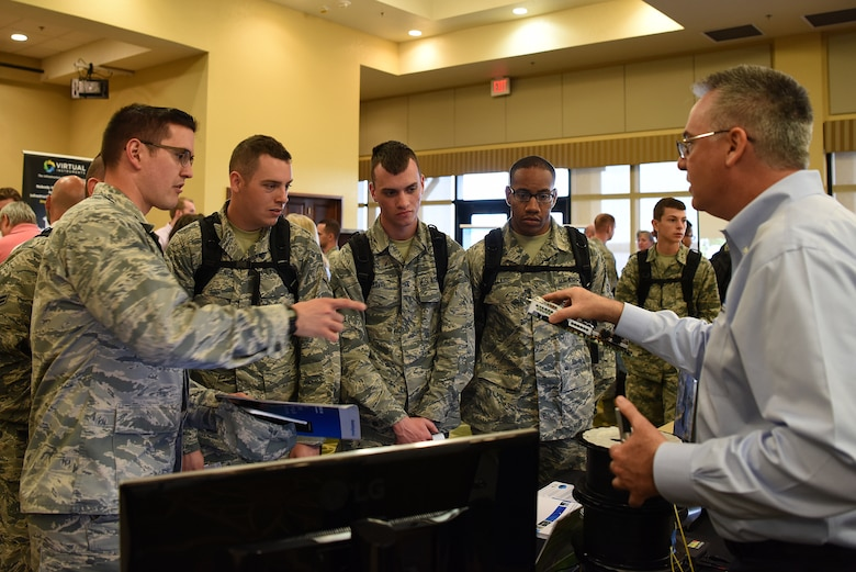 Don Menoher, Thinklogical director of sales, explains the capabilities of a client computer during the 2018 Keesler Technology Expo at the Bay Breeze Event Center Feb. 27, 2018, on Keesler Air Force Base, Mississippi. The expo was hosted by the 81st Communications Squadron and was free to all Defense Department, government and contractor personnel with base access. The event was held to introduce military members to the latest in technological advancements to bolster the Air Force's capabilities in national defense. (U.S. Air Force photo by Airman 1st Class Suzanna Plotnikov)