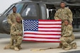 "Captain Echette Washington, Chief Warrant Officer 3 Troy Willis, Sgt. John Chambliss, and Staff Sgt. Jackie Edwards from Alpha Company, ""Task Force Voodoo"", 1st Assault Helicopter Battalion, 244th Aviation Regiment, Louisiana National Guard pose on the flight line, Camp Buehring, Kuwait, Feb. 27, 2018. The flight featured an all-African-American crew in recognition of Black History Month and the growth that has occurred within the aviation community over time."