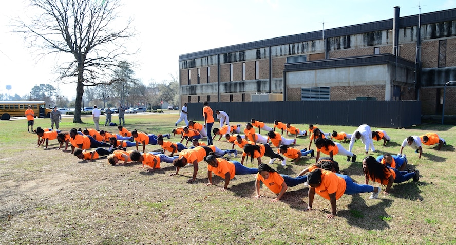 West Lowndes and Columbus High School students do push-ups Feb. 23, 2018, on Columbus Air Force Base, Mississippi. The student are enrolled in a Too Good for Drugs program, which promotes healthy living and smart life choices.  (U.S. Air Force photo by Airman 1st Class Beaux Hebert)