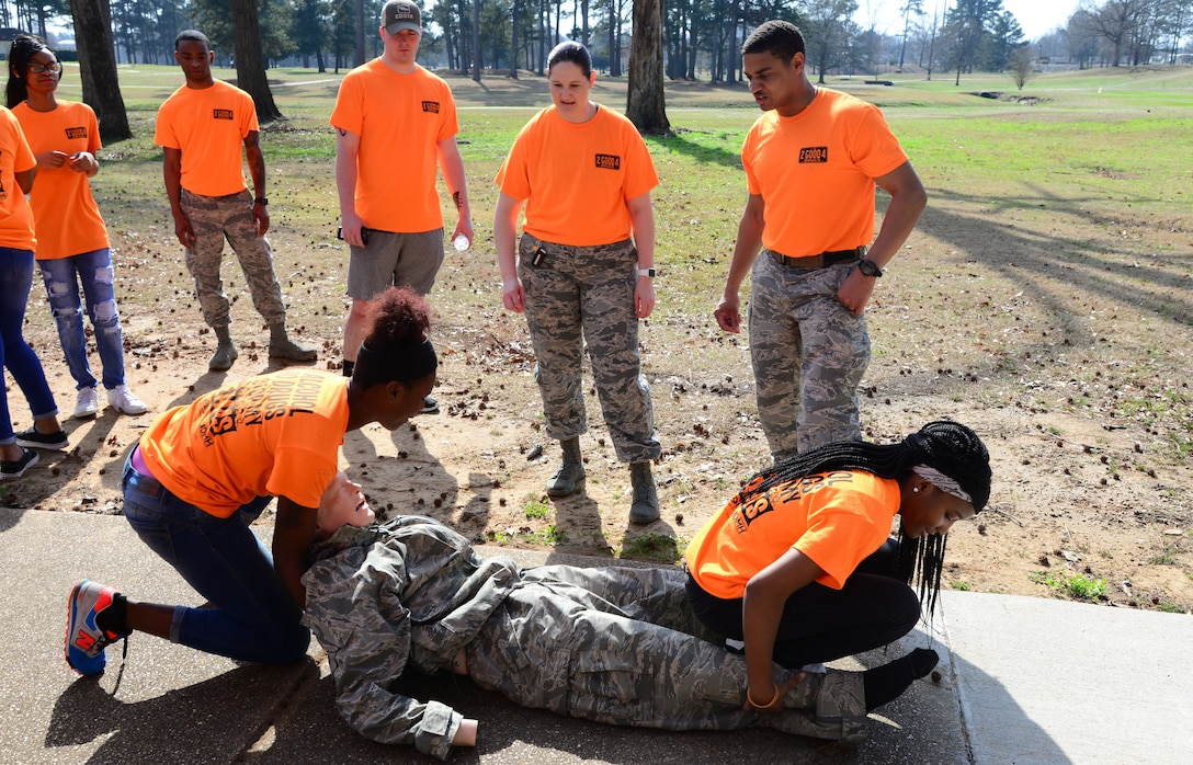 Two students from West Lowndes High School participate in a self-aid buddy care demonstration Feb. 23, 2018, on Columbus Air Force Base, Mississippi. The students completed an obstacle course consisting of five different stations which taught them different ways to stay healthy or safe. (U.S. Air Force photo by Airman 1st Class Beaux Hebert)