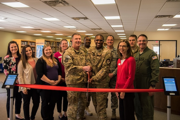 Wing leadership and community members perform a ribbon cutting ceremony for the re-opening of the Cannon Library on Cannon Air Force Base, N.M., March 1, 2018. The new additions to the library include an expanded children's room, a multi-purpose room, a larger sitting area and quiet study rooms. (U.S. Air Force Photo by Airman 1st Class Vernon R. Walter III/Released)