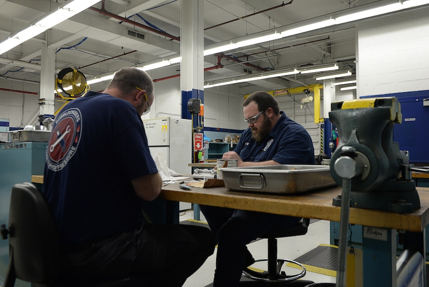 "Terrell  ""Obie"" Hilley and Billy Cox, hydraulic technicians assigned to the 97th Maintenance Group, work on aircraft parts in the hydraulic shop February 27, 2018, Altus Air Force Base, Okla. The hydraulic shop recently reached 5,000 days with no injuries or lost time due to safety incidents. (U.S. Air Force photo by Airman Jeremy Wentworth/released)"