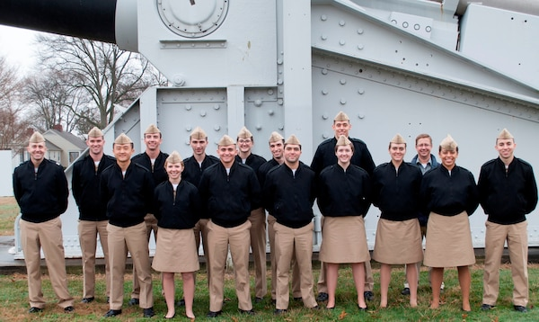 IMAGE: DAHLGREN, Va. (Feb. 23, 2018) - University of Virginia Naval Reserve Officers Training Corps (ROTC) Midshipmen pause in front of a U.S. Navy 16-inch battleship gun on the parade field during their tour of Naval Surface Warfare Center Dahlgren Division (NSWCDD). Lt. Aaron Brotman, assistant professor of naval science for the university's ROTC program, left, and Chris Hodge, NSWCDD director of technical development, are pictured with the 14 Midshipmen in front of a gun that served aboard USS New Jersey (BB-62) before it was retired to Naval Support Facility Dahlgren. Navy scientists and engineers briefed the future naval officers on technologies and facilities such as warfare analysis, laser weapon testing and development, and MOATS - the Maginot' Open Air Test Site. MOATS has been specifically designed for testing the radio frequency susceptibility of electronic equipment to potential high power microwave weapon systems. The Midshipmen saw how NSWCDD engineers conduct lethality work impacting the evaluation of high energy laser technology in addition to the design and development process required to integrate future laser weapon systems in various platforms. NSWCDD scientists and engineers discussed various aspects of electrical and computer engineering, including systems the ROTC Midshipmen would be interacting with as Navy and Marine Corps officers.