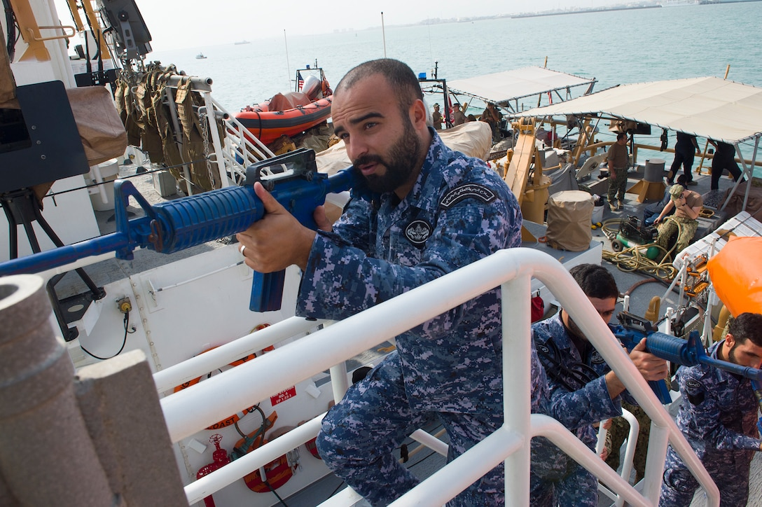 (Feb 28, 2018) During Neon Response 18, Royal Bahrain Naval Force service members prepare to clear the bridge of a suspected hostile vessel during a visit, board, search and seizure, close quarter combat training exercise. Neon Response 18 is a bilateral security and training exercise between the U.S. Navy, U.S. Coast Guard, and the Royal Bahrain Naval Force. (U.S. Navy photo by Mass Communication Specialist 1st Class Ernesto Bonilla/Released)