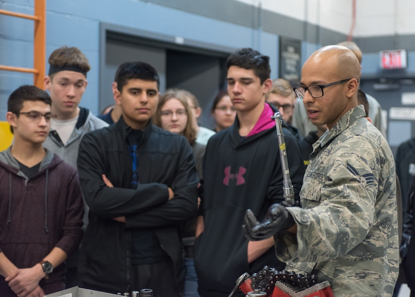 Senior Airman Angel Sanchez, 55th Maintenance Squadron Consolidated Support Flight aircraft hydraulics journeyman speaks to students from Bellevue East High School Feb. 27, 2018 at Offutt Air Force Base, Nebraska. The tour highlighted the roles that both military and civilian Airmen hold here and what it takes to keep Offutt AFB's aircraft mission ready. (U.S. Air Force photo by Senior Airman Jacob Skovo)