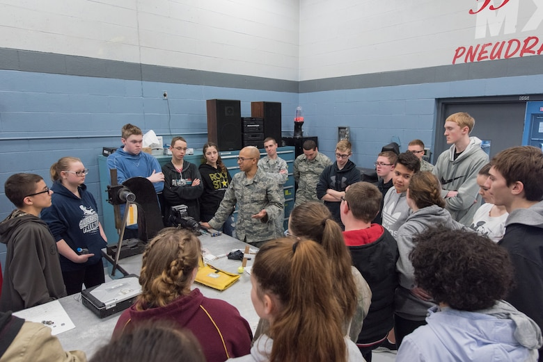 Senior Airman Angel Sanchez, 55th Maintenance Squadron Consolidated Support Flight aircraft hydraulics journeyman speaks to students from Bellevue East High School Feb. 27, 2018 at Offutt Air Force Base, Nebraska. The tour, which was the first of its kind, provided students a chance to see into the world of aircraft maintenance and reflect on real world applications of what they've learned in school. (U.S. Air Force photo by Senior Airman Jacob Skovo)