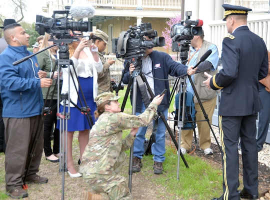 Lt. Gen. Jeffrey Buchanan (right), commanding general of U.S. Army North (Fifth Army), at JBSA-Fort Sam Houston, is interviewed by members of several San Antonio television stations after the ceremony honoring Lt. Benjamin Foulois, who made the first military flight on Marc 2, 1010, at Fort Sam Houston.