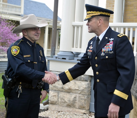 Lt. Gen. Jeffrey Buchanan (right), commanding general of U.S. Army North (Fifth Army), at Joint Base San Antonio-Fort Sam Houston, greets Bexar County Sheriff Javier Salazar (left) at the Foulois House after the ceremony celebrating the first military flight by Lt. Benjamin Foulois March 2.