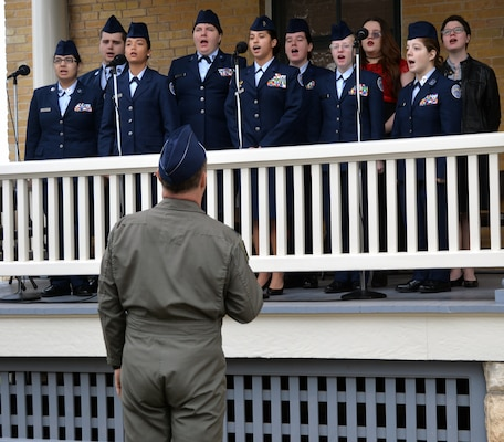 members of the Floresville High School Air Force Junior ROTC Chorale sings the national anthem during the 108th anniversary celebration of the first military flight made by Army Lt. Benjamin Foulois at Joint Base San Antonio-Fort Sam Houston on March 2, 1910.