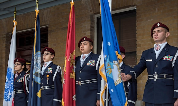 Members of the Pearsall High School Air Force Junior ROTC present the colors of each military service during a medley of armed force songs at the end of the celebration of the 108th anniversary of the first military flight made by Army Lt. Benjamin Foulois at Joint Base San Antonio-Fort Sam Houston on March 2, 1910.