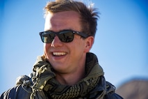 Airman 1st Class Christopher Beeson, 3d Air Support Operations Group Tactical Air Control Party specialist, smiles prior to co-directing an air strike during a rotation at Ft. Irwin, California's National Training Center, Feb. 20, 2018. During the month-long rotation, 93d Air Ground Operations Wing units embedded with approximately 4,000 soldiers in the largest force-on-force live-fire exercise in the world. The 93d AGOW provided tactical air control party support to enhance interoperability for major combat operations downrange. (U.S. Air Force photo by Senior Airman Greg Nash)