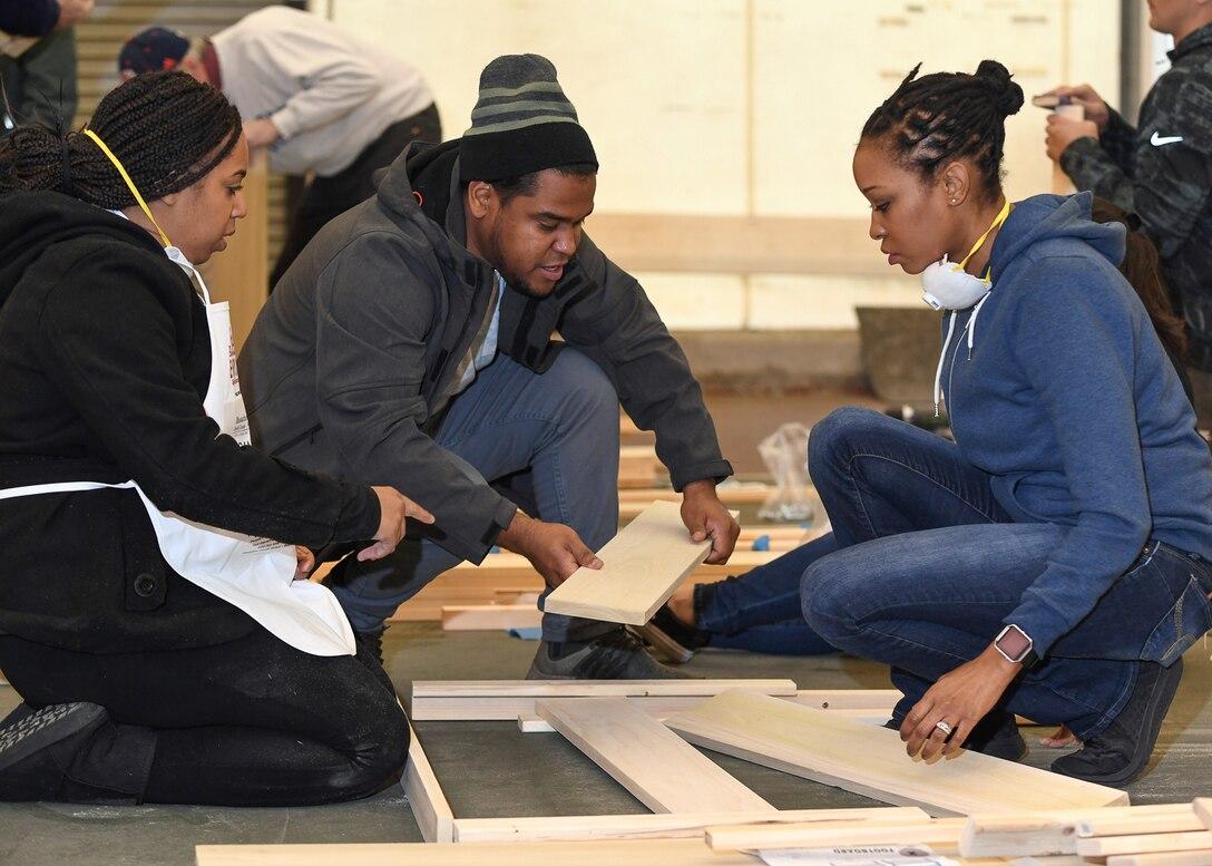Volunteers build beds