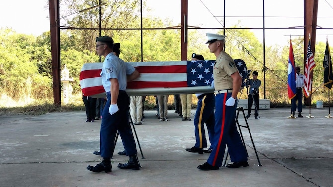 Tech. Sgt. Garrett Wright, 22nd Operations Support Squadron Survival, Evasion, Resistance and Escape and Personnel Recovery specialist, and three other service members carry a casket during a repatriation ceremony.