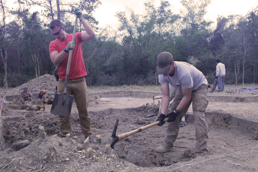 Tech. Sgt. Garrett Wright, 22nd Operations Support Squadron Survival, Evasion, Resistance and Escape and Personnel Recovery specialist, excavates a ten-by-ten foot grid square in Laos while searching for belongings and remains of an Airman missing in action since the Vietnam War.