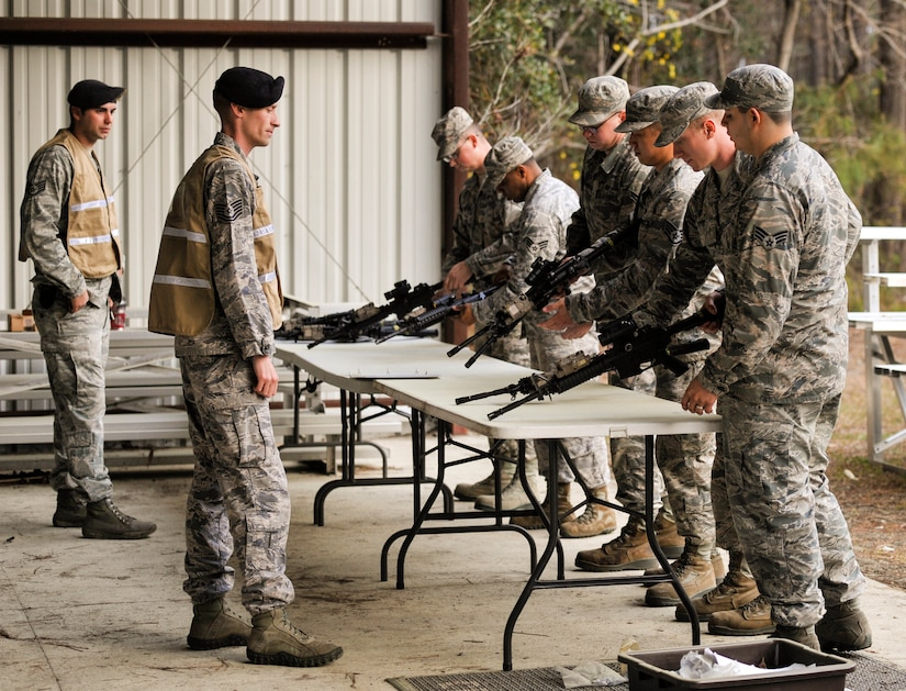 Airmen clear weapons during Mobility Exercise Bold Eagle Feb. 28, 2018, at Joint Base Charleston, S.C.