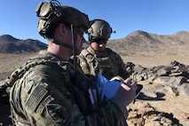 Senior Airman Nicholas Ward, left, and fellow 3d Air Support Operations Group Tactical Air Control Party specialist Airman 1st Class Jaron Maddox, records target threat areas to relay to pilots during a close-air support exercise as part of a Ft. Irwin, Calif. National Training Center rotation, Feb. 20, 2018. During the month-long rotation, 93d Air Ground Operations Wing units embedded with approximately 4,000 soldiers in the largest force-on-force live-fire exercise in the world. The 93d AGOW provided tactical air control party support to enhance interoperability for major combat operations downrange. (U.S. Air Force photo by Senior Airman Greg Nash)