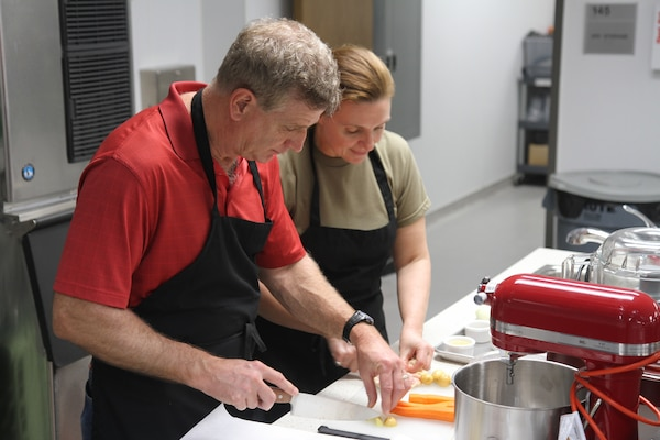 Lt. Col. Christine Edwards (right), an Army dietician, prepares food alongside of her husband, David Abraham, during a marriage enrichment class at the Vogel Resiliency's teaching kitchen Feb. 23  at Joint Base San Antonio-Fort Sam Houston.