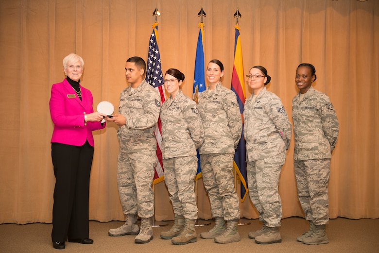 Georgia Lord, mayor of Goodyear, is presented an achievement award by the Women's History committee during the Women's History Month breakfast at Luke Air Force Base, Ariz., March 1, 2018. Lord spoke to a crowd of attendees during the event, which kicked off Luke's Women's History Month celebration. (U.S. Air Force photo/Senior Airman Ridge Shan)