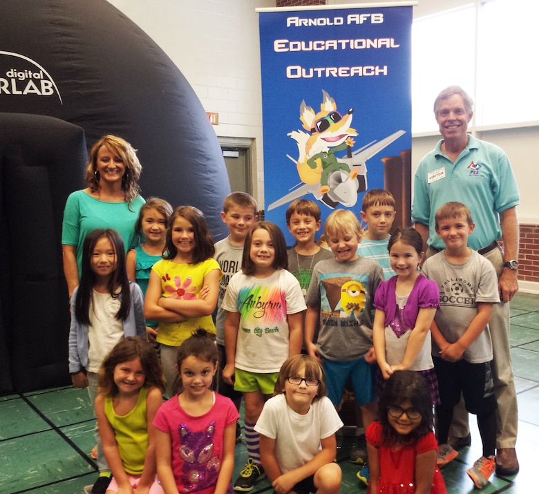 Jere Matty (far right), Arnold Air Force Base Science, Technology, Engineering and Mathematics Center coordinator, records history with Bel Aire Elementary School in Tullahoma by taking a photo after speaking to the group about planets and stars using the Discovery Dome. The Discovery Dome is one of the learning tools that will be transferred to the Hands-on Science Center in Tullahoma through and Air Force STEM Program partnership. (Courtesy photo)