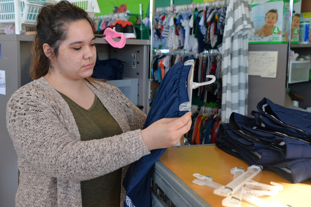 Joslin Knightstep, Airman's Attic volunteer coordinator, sorts donated clothes Feb. 26 ,2018, at Malmstrom Air Force Base, Mont.