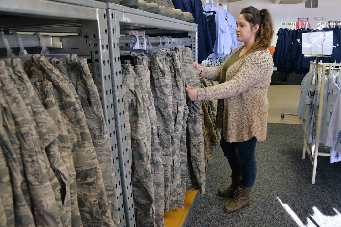 Joslin Knightstep, Airman's Attic volunteer coordinator,  looks through military clothing Feb. 26, 2018, at Malmstrom Air Force Base, Mont.