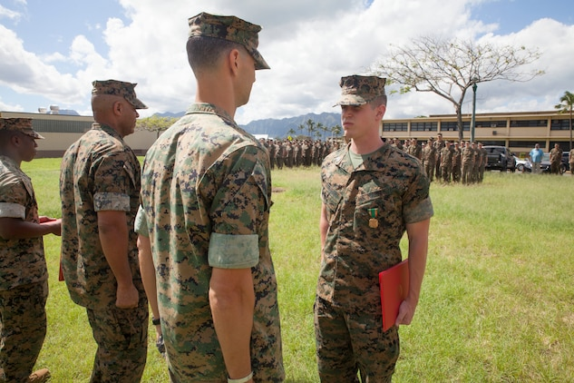 Sgt. Jeffrey Igleheart, a signals intelligence analyst with 3rd Radio Battalion, is awarded the Navy and Marine Corps Achievement Medal, Marine Corps Base Hawaii, Feb. 16, 2018. Three Marines, including Igleheart, conducted a late night search and rescue for a lost hiker back in January 2018. The Marines covered 10 miles at about 3000 feet in elevation under rainy conditions, eventually finding and returning back with the hiker. (U.S. Marine Corps photo by Sgt. Jesus Sepulveda Torres)