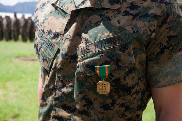 Sgt. Jeffrey Igleheart, a signals intelligence analyst with 3rd Radio Battalion, is awarded the Navy and Marine Corps Achievement Medal, Marine Corps Base Hawaii, Feb. 16, 2018. Three Marines, including Igleheart, conducted a late night search and rescue for a lost hiker in January 2018. The Marines covered 10 miles at about 3000 feet in elevation under rainy conditions, eventually finding and returning back with the hiker. (U.S. Marine Corps photo by Sgt. Jesus Sepulveda Torres)
