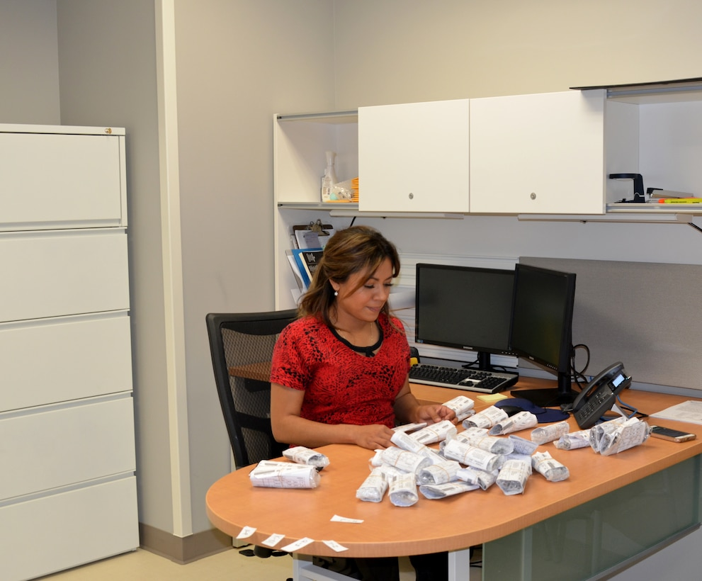 Opthalmic technician Maggie Padro sorts eyeglasses in the new medical clinic, Feb. 23, 2018.