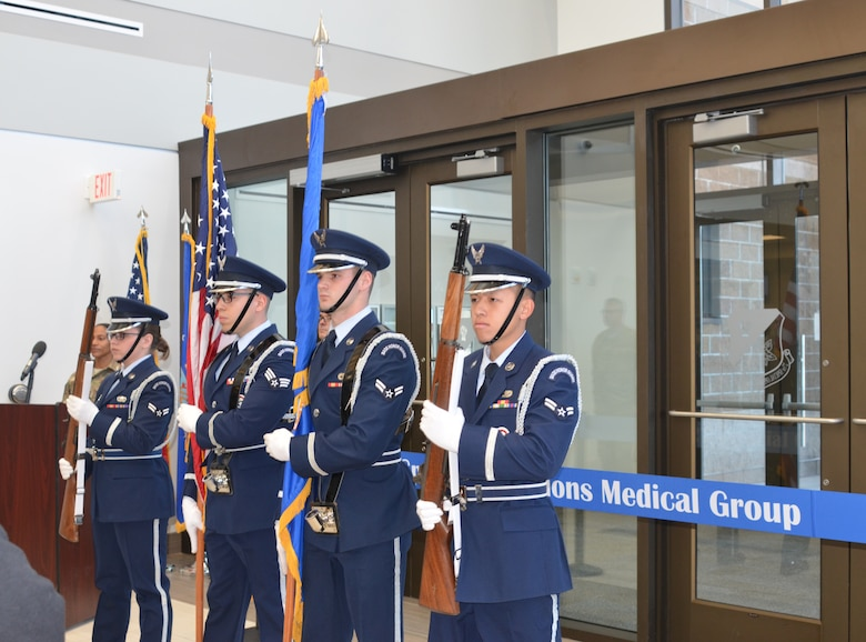 The honor guard present the flags during the ceremony, Feb. 23, 2018.