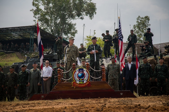 U.S. Navy Adm. Harry Harris, commander, U.S. Pacific Command, and Gen. Thanchaiyan Srisuwan, Chief of Defense Forces in Thailand, and U.S. Ambassador to Thailand Glyn Davies, address the troops after a combined arms live fire exercise during Exercise Cobra Gold 18