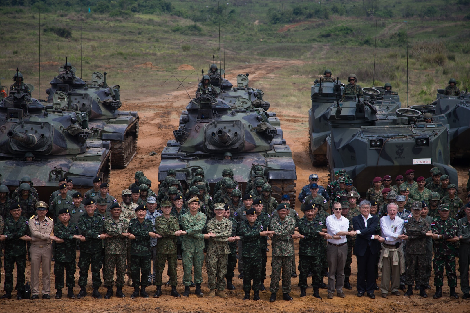 U.S. Navy Adm. Harry Harris, commander, U.S. Pacific Command, Gen. Thanchaiyan Srisuwan, Chief of Defense Forces in Thailand, and U.S. Ambassador to Thailand Glyn Davies, along with other officials, pose for a group photo after a combined arms live fire exercise during Exercise Cobra Gold 18