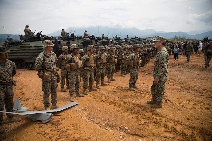 U.S. Navy Adm. Harry Harris, commander, U.S. Pacific Command, meets with U.S. Marines after a combined arms live fire exercise during Exercise Cobra Gold 18