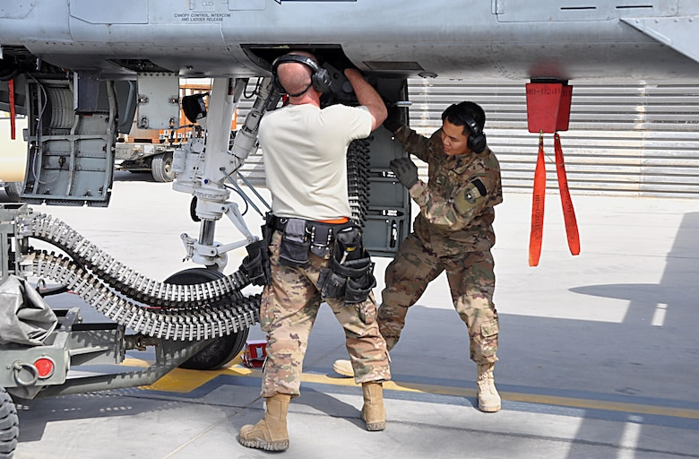 Tech. Sgt. Nathan Wesley and Airman 1st Class Rey Nino Estrella, weapons loader Airmen assigned to the 303rd Expeditionary Fighter Squadron, reload the 30mm gun on an A-10 Thunderbolt II before a mission at Kandahar Airfield, Afghanistan, Feb. 10, 2018.