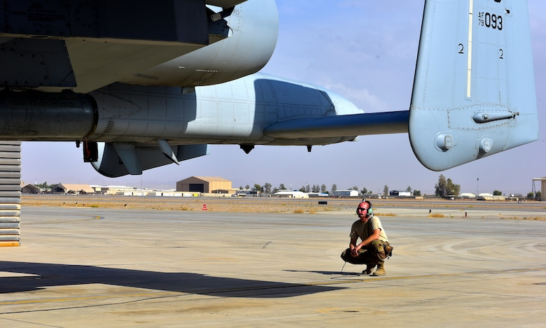 Master Sgt. John Tischhauser, 303rd Expeditionary Fighter Squadron production expeditor, performs a preflight inspection on an A-10 Thunderbolt II at Kandahar Airfield, Afghanistan, Feb. 27, 2018.