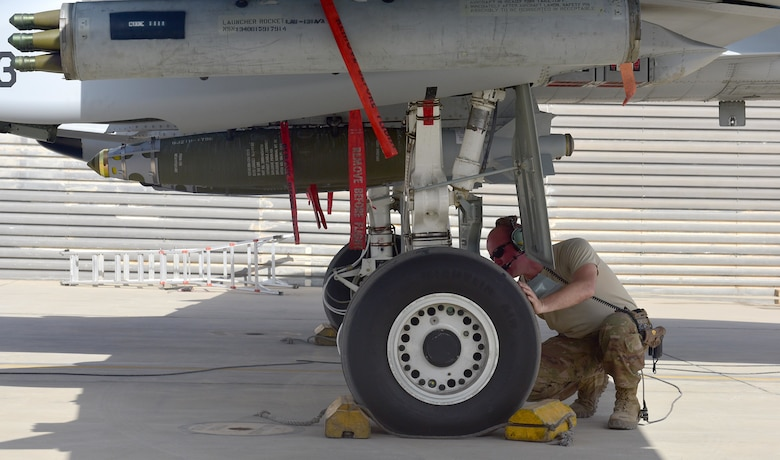 Master Sgt. John Tischhauser, 303rd Expeditionary Fighter Squadron production expeditor, prepares an A-10 Thunderbolt II for takeoff at Kandahar Airfield, Afghanistan, Feb. 27, 2018.