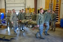 114th Fighter Wing Airmen perform the proper procedures of a litter carry as part of the Self-Aid & Buddy Care (SABC) hands-on training during the 114th Fighter Wing Readiness Training March 3, 2018, Joe Foss Field, S.D.