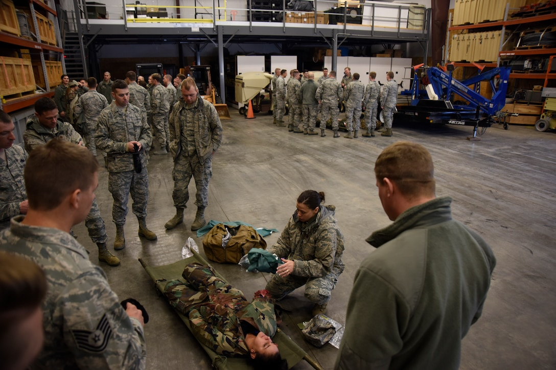 Maj. Rochelle Prickett, 114th Medical Group clinical nurse, explains how to deal with combat wounds during the the 114th Fighter Wing Readiness Training March 3, 2018, Joe Foss Field, S.D.