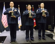 Master Sgt. Charles Woods (left), on behalf of award recipient Sgt. Raul Rodriguez; Staff Sgt. Daniel Keller (center); and Senior Master Sgt. Kevin Seifert (right) are honored as the Kentucky Air Guard's Outstanding Airmen of the Year during a banquet at Papa John's Cardinal Stadium Louisville, Ky., on March 3, 2018.