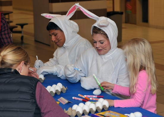 AB Eric Jeronimo and SSgt. Jessie Motley, 185 Air Refueling Wing, Force Support Squadron, Sioux City, Iowa, sport bunny costumes while helping the younger children color Easter eggs at the Spring Fling, at the Sergeant Bluff middle school on Saturday, 3 March, 2018.  The Spring Fling is a morale building event hosted by the 185th ARW Bats Family Club.  (U.S. Air National Guard photo by Master Sgt. Bill Wiseman/Released)